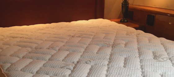 Custom mattresses & bedding throughout this beautiful Viking  55 in Seabrook Marina